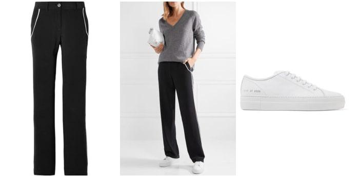 Широкие черные штаны могут быть дополнены классическими белыми кедами