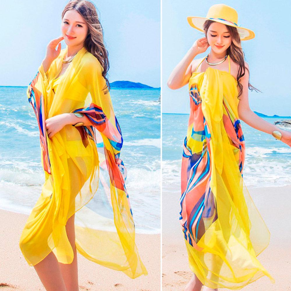 Парео — неотъемлемый атрибут пляжного отдыха.